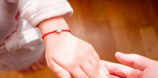 Почему никогда не стоит носить на руке красную нить